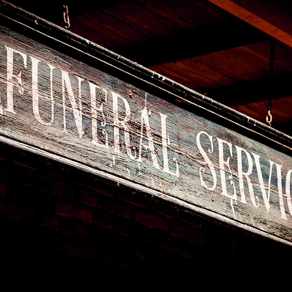 1970 funeral home sign from a funeral directors