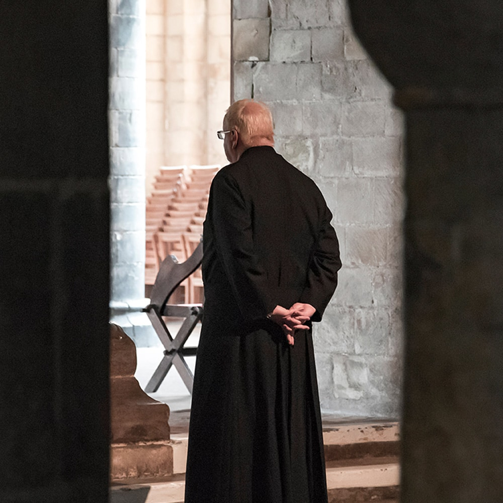 Priest attending churches funeral after pandemic